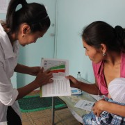 Medical staff consulting young moms on nutrition