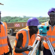 Workers survey a biomass site in Kenya.