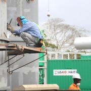 A laborer works on a USAID-funded power plant at Caracol Industrial Park in northern Haiti, April 2012.