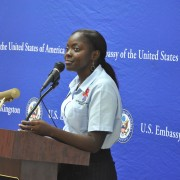 Tennesha Rhule conveys her story to members of the U.S. Embassy community at an HIV forum in 2012.