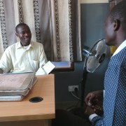 Misozi Banda, left, reviews referrals for the day with Martin Banda,