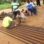 A local welder fabricates the photovoltaic array structure designed by GVE Projects.