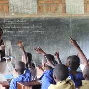 Teacher Beatha Nikuze interacts with students in her third grade classroom at Kanyinya Primary School.