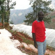 Michel Dorlean stands in front of his flower growers' association's greenhouses in Furcy.