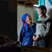 Avaz and his mother are happy that they finally received a birth certificate with the help of a free legal aid center. USAID help to open 10 of such centers across Kyrgyzstan.