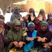 Nigerien girls discuss hand washing in a community Safe Space club