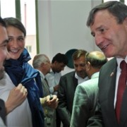 The U.S. Ambassador Karl W. Eikenberry speaks to the deputy minister of education Asif Nang during re-opening ceremony of the Tu