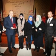 The U.S. Ambassador James Cunningham with the members of the winning team from Herat University.