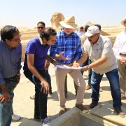 U.S. Ambassador Beecroft and others view a draining pump that protects the Sphinx from groundwater