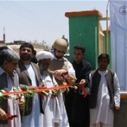 Afghan officials cut a ribbon to launch new municipal projects in Farah City.