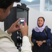 Staff of the new Hirat Multimedia Center record an interview with Jeannette Vail, USAID democracy and governance officer.