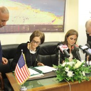 USAID Mission Director Sherry F. Carlin and Ministry of International Cooperation Sahar Nasr sign a bilateral agreement.