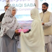 Anisa Imran, Director of Nangarhar's Department of Women's Affairs hands out an award to a graduate of USAID-funded Business Tra