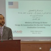 USAID Mission Director Dr. Ken Yamashita speaks at the graduation ceremony for on-the-job training program at the Ministry of En
