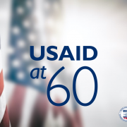 USA flag with USAID's 60th Anniversary-French
