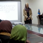 Sarah Meyer, Chief of Party of USAID's Trade Accession and Facilitation for Afghanistan speaking to the students