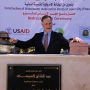 U.S. Ambassador to Egypt Stephen Beecroft lays a ceremonial brick at the groundbreaking of the Luxor wastewater treatment plant expansion.