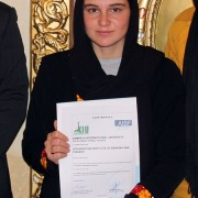 One of the graduates displays her diploma in Managerial Accounting after the graduation ceremony.