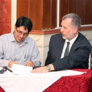 Representative of Geo Search Company (GSC), an Afghan Marble extraction and processing plant, signs the Public-Private Alliance
