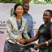 Chargé d'Affaires Inmi Patterson shakes hands with Community Health Volunteer Joyce Paulo