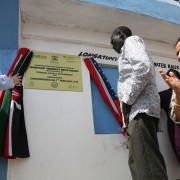 Global Water Coordinator James Peters and Turkana Governor Josphat Nanok officially commission the Lorengelup Community Water Project. Looking on is USAID's Mission Director for Kenya and East Africa Tina Dooley-Jones
