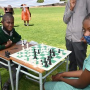 Seven-graders Josef Iifo and Yassira Princess Ndapopilwa are battling it out in a match with one of the donated chess boards.