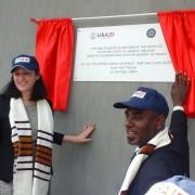USAID Representative Sophia Brewer and the mayor of Hawassa uncover a plaque for the new Finchawa Health Center.