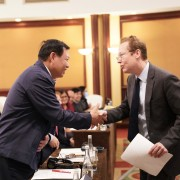 Vietnam's Vice Minister of Health Do Xuan Tuyen and U.S. Deputy Chief of Mission Christopher Klein shake hands during the event.