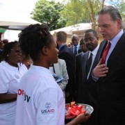 A photo of the U.S. Ambassador to Zambia, Daniel L. Foote, as he accepts the integration plan during the official handover of 16 U.S.-funded anti-GBV One-Stop Centers.