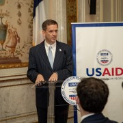 Administrator Mark Green speaks at a podium at theGeorge C. Marshall Center, Paris, France