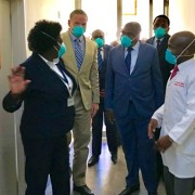 U.S. Ambassador Daniel L. Foote (lc) and Zambia's Minister of Health Dr. Chitalu Chilifya (cr) on a tour during the handover of the new TB Ward.