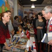 US Ambassador to Armenia John Heffern stops by the visitor booth of Turkish partners at the event.