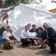 U.S. Ambassador Rena Bitter and Lao Vice Minister of Health Khamphone Phoutthavong Tried out Bednets during a Handover Ceremony in Vientiane