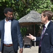 Ambassador Miller discusses the USAID initiative and its community-rooted approach with YALI Fellow, Monametsi Sokwe.