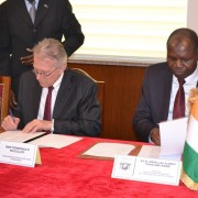 U.S. Ambassador Terence P. McCulley and the Minister of Foreign Affairs, Dr. Abdallah Albert Toikeusse Mabri, sign the Grant Agr
