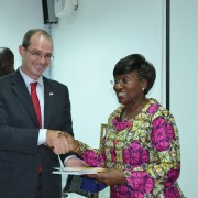 USAID Country Director shakes hand with Ivorian Minister of Health as he remits the new healthcare policy