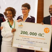 U.S. Ambassador Patricia Haslach presents an award to Rahel Moges, the winner of an innovation business plan competition.