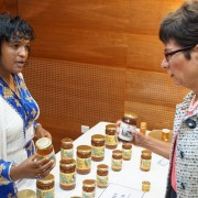 Simret Lulekal, the owner of SYE Agroindustry, discusses her company's products with U.S. Ambassador Haslach. SYE works with 600