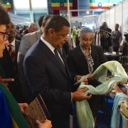 Ethiopian President Mulatu Teshome and U.S. Ambassador Haslach look at merchandise from one of the exhibits at the fifth Origin