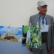 A farmer from Pchinja follows the discussion with the agriculture experts on climate change