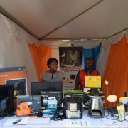 Vendors at the Solar Expo demonstrate a range of solar-powered products.