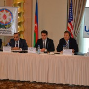 The chairman of the NGO Council presents the draft law to the participants