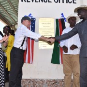 U.S. Ambassador to Kenya, Robert Godec, shakes hands with the Governor of Turkana County, Josphat Nanok after officially opening the Lodwar Livestock Market. Looking on is the Cabinet Secretary for Arid and Semi-arid Lands Eugene Wamalwa and USAID's Deputy Mission Director Heather Schildge.