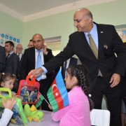 The Mission Director presents gifts to children during the tour of the renovated kindergarten.