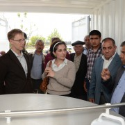 Local residents join USAID staff to tour the facility