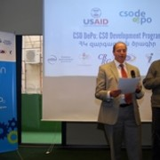 Head of USAID Armenia Program Office, Mervyn Ellis, speaks at the public launch of the CSO DePo program.