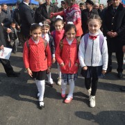 Schoolchildren walk on the newly renovated road.