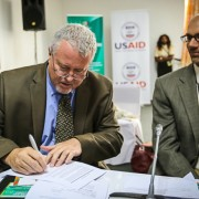 Photo: USAID Economic Development Office Director Jeremy Boley (r) looks on as Mission Director Patrick Diskin (l) signs a Letter of Intent to support the Zambian Government as it scales up programs to improve nutrition and combat stunting across the nation.