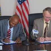 Central Statistical Agency Director General Biratu Yigezu (left) and USAID Ethiopia Mission Director Dennis Weller sign an agree