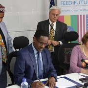 Image of Ethiopia Minister of Agriculture and USAID Deputy Administrator Glick signing Feed the Future partnership